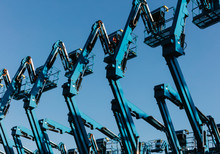 Row Of Hydraulic Mobile Cherry Picker Platforms At Outdoor Storage Facility,Hydraulic Cranes