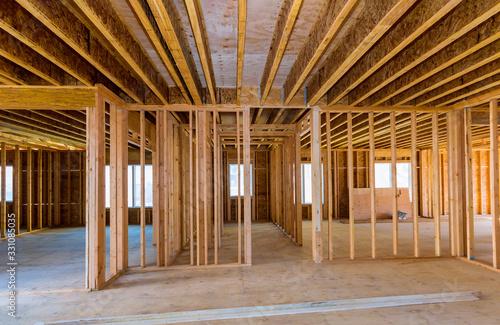 Obraz Framing beam of new house under construction home framing - fototapety do salonu