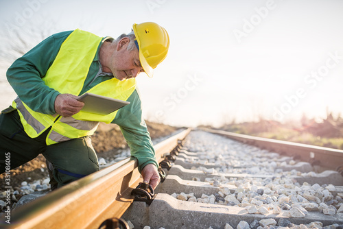 Fototapeta Railroad workers checking railways