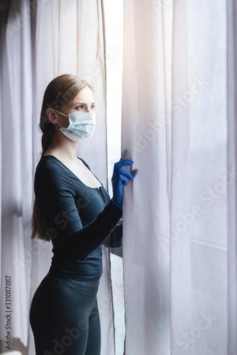 Bored woman in corona quarantine or under curfew - 331087087