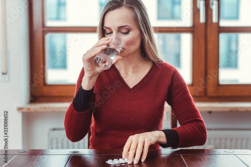 Stampa su Tela Woman feeling sick or unwell and taking medication
