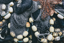 Pile Of Commercial Fishing Nets And Gill Nets On A Fishing Quay.,Seattle