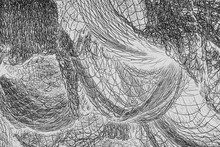 Inverted Black And White Image Of Commercial Fishnets And Ropes On A Fishing Quay.,Seattle