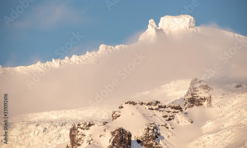 Wide angle shot of the top of a glacier against a clear blue sky