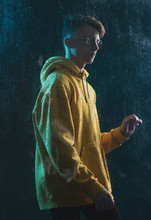 A Young Guy In A Yellow Hoodie...