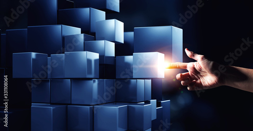 Photo Hand holding glowing cubes. Innovation and creativity concept.