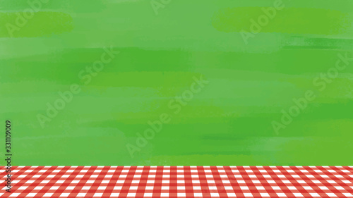 ピクニックの背景、芝生と赤いチェックのテーブルクロス