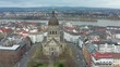 Aerial cinematic shot of the christus church in mainz with the river rhine in the background 25p