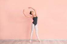 Beautiful Young Ballerina Near Color Wall
