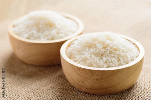 Fototapeta Organic Thai Jasmine rice grain in a bowl preparing for cooked obraz
