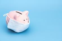 .Pink Piggy Bank Stands On A B...