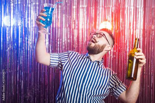 Fotografie, Obraz Alcoholism, fun and fool concept - Drunk guy at party in a nightclub
