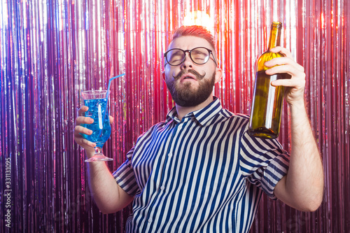 Fototapeta Alcoholism, fun and fool concept - Drunk crazy guy at party in a nightclub