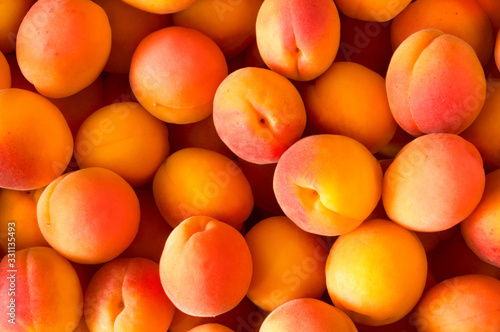 Many fresh ripe beautiful apricot fruits top view Fotobehang