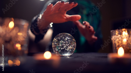 Fotografía Close-up of woman fortune-teller's hands with ball of predictions
