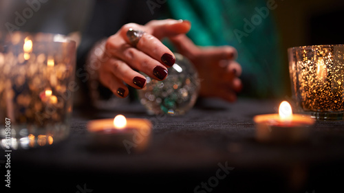 Photo Fortuneteller female's hands with predictions ball