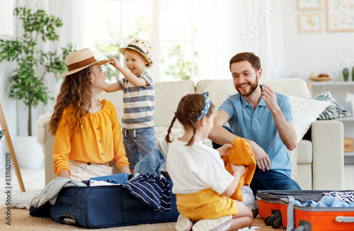 Playful family packing for holiday at home Canvas