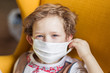 Child toddler in a mask from coronavirus. Protection against infection. Carriers of the disease without symptoms. Child pandemic safety