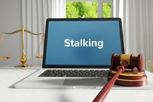 Stalking – Law, Judgment, Web. Laptop In The Office With Term On The Screen. Hammer, Libra, Lawyer.