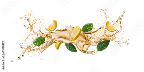 tea wave splashing with tea leaves and lemon slices, isolated on white Tablou Canvas