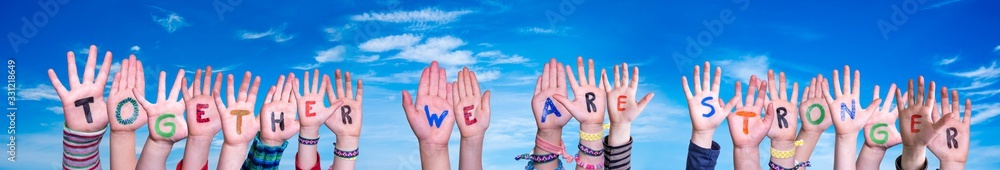 Fototapeta Children Hands Building Colorful Word Together We Are Stronger. Blue Sky As Background