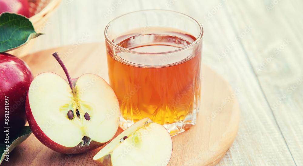 Fototapeta Apple juice in a glass. Selective focus.