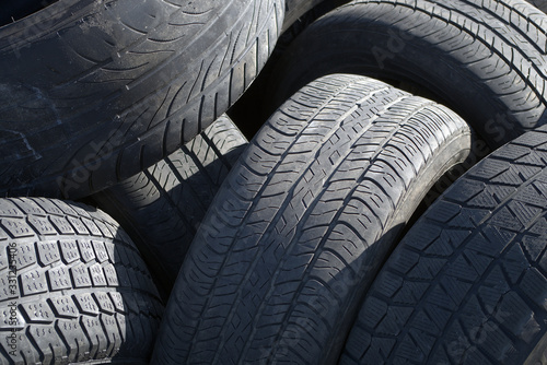 Fotomural many tires car wheels rubber recycling garbage
