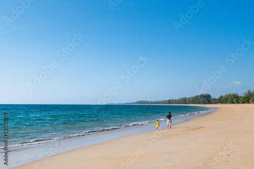 Obraz na plátně father and son walking in happy moment on Mai Khao beach, Talang, Phuket in Suns