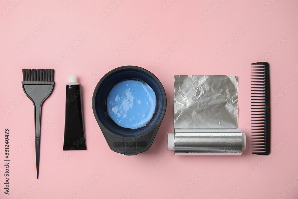 Fototapeta Professional tools for hair dyeing on pink background, flat lay