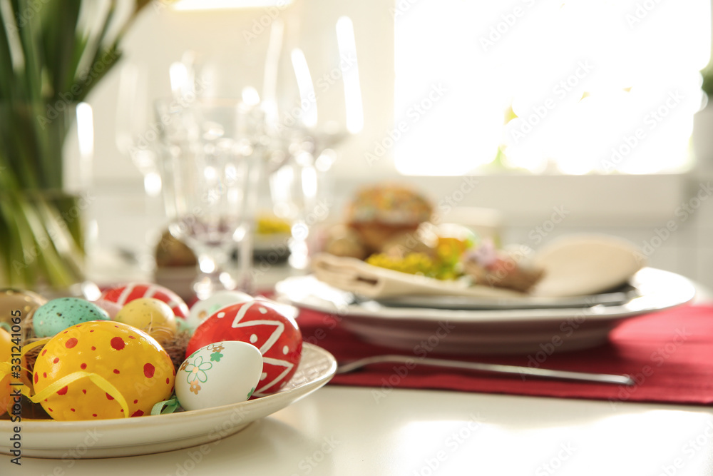 Fototapeta Festive Easter table setting with decorated eggs, closeup