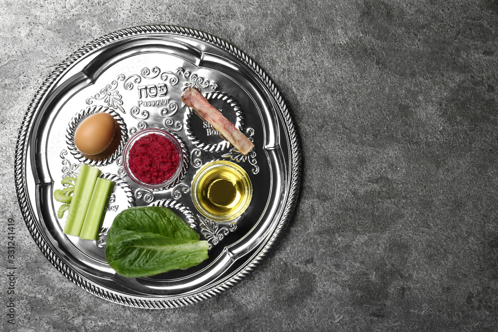 Fototapeta Passover Seder plate (keara) on grey table, top view with space for text. Pesah celebration