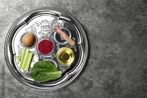Obraz Passover Seder plate (keara) on grey table, top view with space for text. Pesah celebration - fototapety do salonu