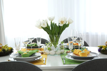 Festive Easter Table Setting With Beautiful White Tulips And Eggs Indoors