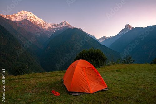 An orange tent with beautiful view of Annapurna mountains range in Annapurna Sanctuary, Nepal at dawn Canvas Print