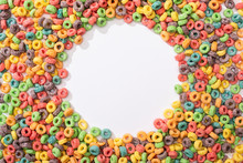 Top View Of Bright Multicolored Breakfast Cereal Arranged In Round Frame On White Background