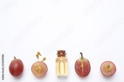 Fotografija Composition with natural grape seed oil on white background, top view