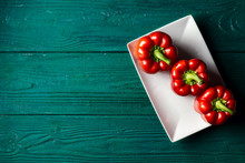 Red Bell Pepper On A Wooden Ba...