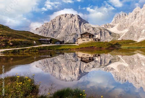 Wall mural - Majestic Mount with beautiful reflections in the lake. Amazing nature landscape. Wonderful Dolomites Alps.