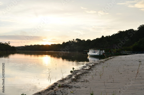 boat and pier at dawn on one of the tributaries of the Amazon in Brazil Canvas-taulu