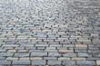 Ancient paving stones made of rectangular stone bricks. Textured background