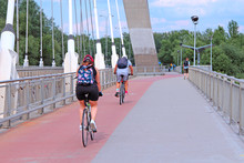 Cyclists Ride Bicycles On Brid...