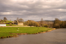 River Bank With Abbey Ruins.