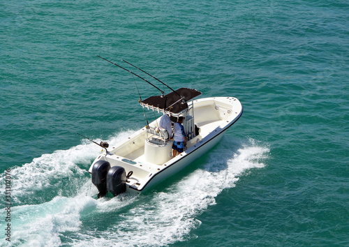 Valokuvatapetti Angled overhead view of an open sport fishing boat with a black canvas canopied center console powered by two outboard meninges