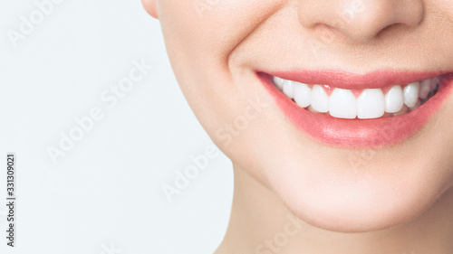 Perfect healthy teeth smile of a young woman. Teeth whitening. Dental clinic patient. Image symbolizes oral care dentistry, stomatology. #331309021