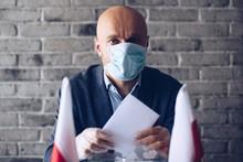 Man In Medical Mask Putting Hi...