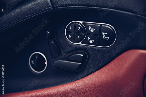 Photo Electric luxury car seat adjust panel. Car interior