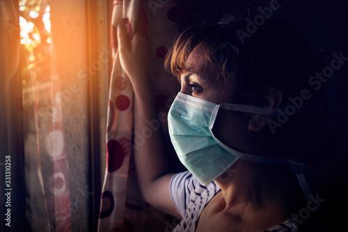 Mujer mirando desde el interior de su casa Canvas Print