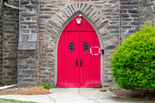 A Bright Red Door Of A Church ...