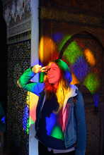 Fashionable Young Woman In Stained Glass Window Light
