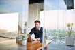 Leinwandbild Motiv Businessman using a laptop while working from home